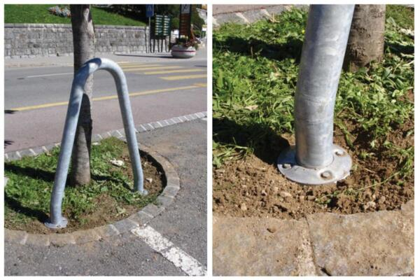 Tree protection bracket with drive-in ground anchor