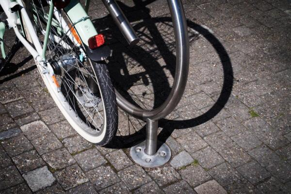 Bike stand with ground anchor bolt